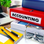 accounting on red ring binder. blurred, toned image.